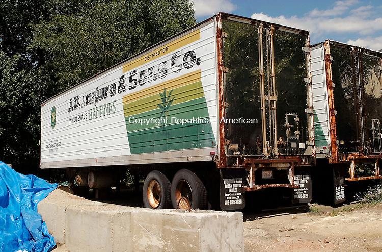 WATERBURY, CT - 20 JUNE 2005 -062005JS03--A pair of J.P. Jarjura & Sons Co. tractor trailers sit in a lot behind Holiday Cinemas 10 in Waterbury.   --Jim Shannon Photo--J.P. Jarjura & Sons Co; Waterbury; Holiday Cinemas 10 are CQ