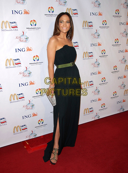 JENNIFER LOPEZ.attends Noche de Ninos Gala benefiting Children's Hospital of Los Angeles held at The Beverly Hilton Hotel, .Beverly Hills, California, USA, October 7th 2006. .full length black strapless dress green waist belt silver glittery clutch bag purse ring jewellery slit split.Ref: DVS.www.capitalpictures.com.sales@capitalpictures.com.©Debbie VanStory/Capital Pictures