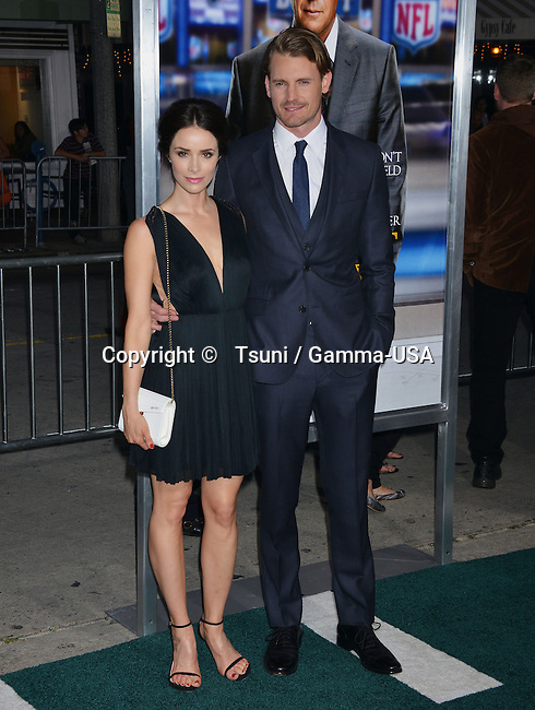 Josh Pence and Abigail Spencer at the Draft Day Premiere at the Westwood Village Theatre in Los Angeles.