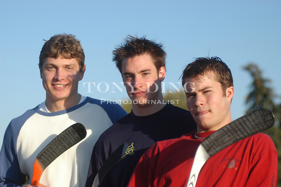 Michigan freshmen and hockey players David Rohlfs, Jason Dest, and T.J. Hensick, in front of Yost Ice Arena on Tuesday, October 7, 2003. (TONY DING/Daily)