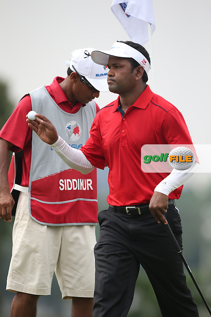 Team Asia's Siddikur Rahman (BANG) wins four consecutive holes on the back nine to defeat Team Europe's Stephen Gallacher (SCO) 4&3 during the final day of Singles matches at the 2014 EurAsia Cup presented by DRB-Hicom, at the Glenmarie Golf & Country Club, Kuala Lumpur, Malaysia. Picture:  David Lloyd / www.golffile.ie