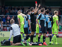 Referee Darren Deadman sends off Goal scorer Carl Magnay of Hartlepool United after a challenge on Ryan Sellers of Wycombe during the Sky Bet League 2 match between Wycombe Wanderers and Hartlepool United at Adams Park, High Wycombe, England on 5 September 2015. Photo by Andy Rowland.