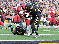 NWA Media/Michael Woods --11/28/2014-- w @NWAMICHAELW...University of Arkansas receiver Keon Hatcher Keon Hatcher pouches past Missouri defender Ian Simon to score a touchdown in the 2nd quarter of Friday afternoons game at Faurot Field in Columbia Missouri.