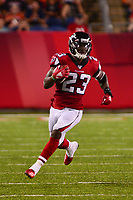 Canton, Ohio - August 1, 2019: Atlanta Falcons running back Brian Hill #23 runs the ball during a pre-season game against the Denver Broncos at the Tom Benson Hall of Fame stadium in Canton, Ohio August 1, 2019. This game marks start of the 100th season of the NFL. (Photo by Don Baxter/Media Images International)