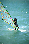 Windsurfing is a surface water sport that combines elements of surfing and sailing.<br /> (2)