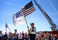 NWA Democrat-Gazette/BEN GOFF @NWABENGOFF<br /> Members of the National Ghost Rider Association present memorial flags bearing the names of those who died in the Sept. 11, 2001 attacks on Saturday Sept. 12, 2015 during the Sheep Dog Impact Assistance annual Patriot Day event at Bentonville Municipal Airport. The event honored the victims of the Sept. 11, 2001 terrorist attacks and offered visitors a chance to get an up close look at military and emergency response vehicles.