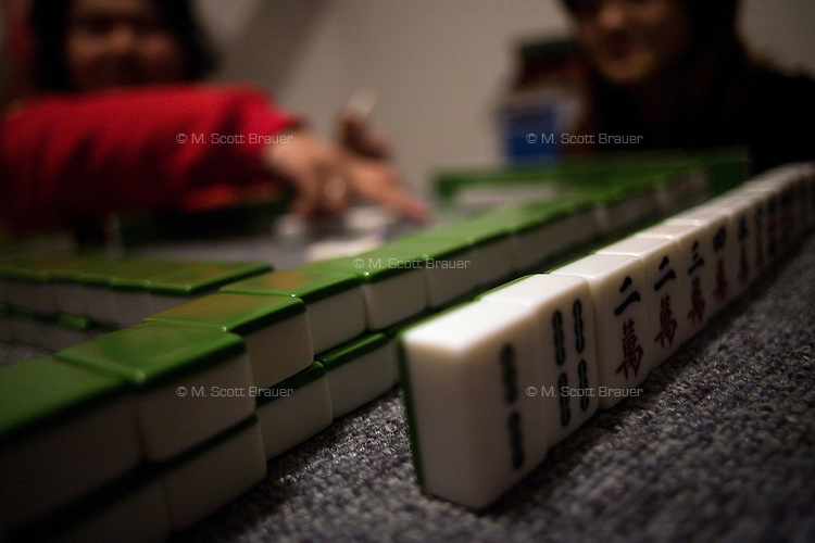 Punk rock musicians play the Chinese tile game Mah Jongg in an apartment in the northern outskirts of Nanjing, China.