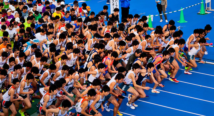 Setagaya half marathon mass start showing close up of front runners in flight.
