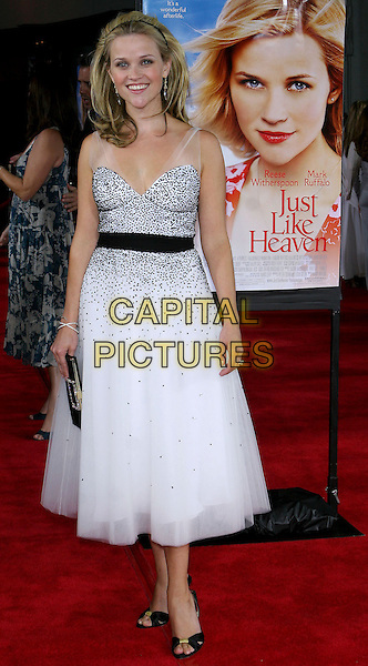 """REESE WITHERSPOON.At the Los Angeles Premiere of """"Just Like Heaven"""" held at Graumann's Chinese Theatre,.Los Angeles, 8th Septeber 2005.full length black white layer chiffon dress crystal earrings alice hair band belt clutch bag open toe sandals.Ref: ADM/JW.www.capitalpictures.com.sales@capitalpictures.com.© Capital Pictures."""