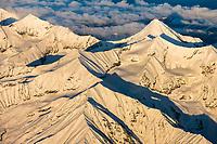 Fresh snow on the Alaska range mountains. Scott peak, the prominent pointed mountain, Denali National Park, interior, Alaska.