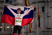 Grand Tour debutant, triple stage winner and white jersey / best young rider Tadej Pogačar (SVN/UAE-Emirates) celebrating on the podium in Madrid<br /> <br /> Stage 21: Fuenlabrada to Madrid (107km)<br /> La Vuelta 2019<br /> <br /> ©kramon