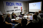 Volunteer Robert Terhune, center, leads a class on the Nevada caucus at Ron Paul's presidential campaign headquarters in Reno, Nev., January 31, 2012.