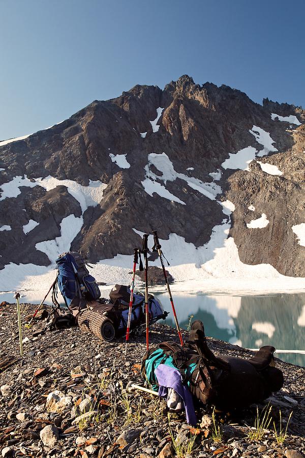 Backpacks in upper Ferry Basin below Pulitzer Peak, Bailey Range Traverse, Olympic Mountains, Washington