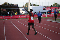 Tuesday 15th July 2014<br /> Pictured: Christian Malcolm<br /> RE: Welsh sprinter Christian Malcolm, waves to spectators  after running his last race on home soil at the Welsh Athletics International in the Cardiff International Sports Stadium, South Wales, UK.