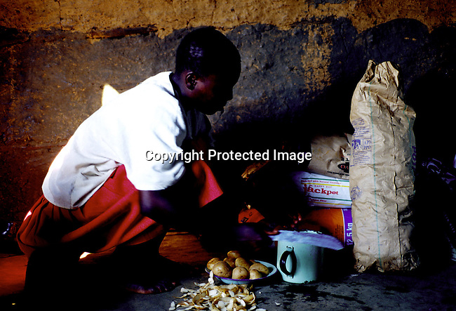 Zethu Shenge, age 16, in her family one-room house on November 15, 1999 in Nqbeni, a rural village in southern Natal, South Africa..The mother is infected by the Aids virus and so is two of her younger siblings. The mother works at a farm and makes about $40 a month. .(Photo: Per-Anders Pettersson/ Liaison Agency)
