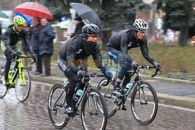 The pelethon including well wrapped Omega Pharma-Quick Step teammates Mark Cavendish (GBR) and Martin Velits (SVK) pass through Pavia during the 104th edition of the Milan-San Remo cycle race, 17th March 2013 (Photo by Eoin Clarke 2013)