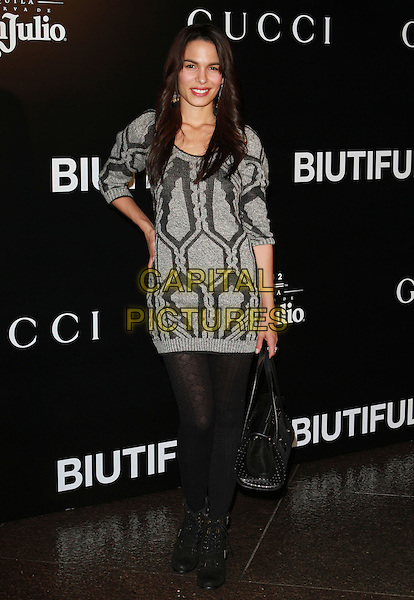 "NADINE VELAZQUEZ.""Biutiful"" Los Angeles Premiere held At The DGA Theatre, Los Angeles, CA, USA, 14th December 2010..full length black grey gray patterned jumper sweater hand on hip tights bag ankle boots .CAP/ADM/KB.©Kevan Brooks/AdMedia/Capital Pictures."