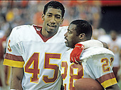 Washington Redskins cornerbacks Barry Wilburn (45) hugs fellow Redskins cornerback Darrell Green (28) following their 20 - 13 victory over the Detroit Lions at RFK Stadium on Sunday, November 15, 1987.  During the game Green intercepted three passes for a total of 65 yards and Wilburn had one interception that he returned 13 yards.<br /> Credit: Arnie Sachs / CNP