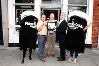 """26/7/2011. Porterhouse Celebrates Fifteen Years of Brewing with another Gold Medal. Pictured at the Sweny Chemist venue in Dublin celebrating are Liam La Hart director, Peter Mosley Master Brewer , Oliver Hughes Director .The Porterhouse Brewing Company is fifteen years old and to add to the celebrations they have been awarded a gold medal for their Plain Porter. The award, which is much sought after by brewers worldwide, was bestowed upon the Porterhouse's famous Plain Porter at the Brewing Industry International Awards, dubbed, """"The Brewing Oscars"""" in a glitzy ceremony at London's Guild Hall. It is the second time the Porterhouse has received this famous accolade. The first was in 1998 and again it was the Plain Porter that brought home the gold. The awards, with approximately eight hundred and fifty entries, are structured into nine categories with thirty-two classes and medals are extremely difficult to win. Picture Collins Photos"""