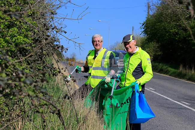 Brian Warren and Pat Roche out cleaning the roadsides in Dunleer<br /> Picture: www.newsfile.ie