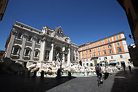 A man goes by bicycle past Fontana di Trevi in central Rome on May 4, 2020 as Italy starts to ease its lockdown, during the countrys lockdown aimed at curbing the spread of the COVID-19 infection, caused by the novel coronavirus.<br /> UPDATE IMAGES PRESS/Isabella Bonotto