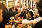 The food tables proved to be a popular spot for those attending the ribbon-cutting and open house for the Durham Performing Arts Center Monday, Dec. 1, 2008.