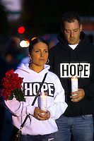 BURLINGTON, WA - SEPTEMBER 26:  Melissa McGee(left) and Shaun Van Horn, from Everett, Washington join hundreds in a candlelight vigil outside the Cascade Mall on September 26, 2016 in Burlington, Washington. Five people were killed by a gunman several nights ago. Among the dead was Van Horn's aunt.  (Photo by Karen Ducey/Getty Images)
