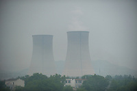 Daytime landscape view from a train of cooling towers at a commercial heavy industry site near Wuhan in Hubei Province.  © LAN