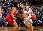 BROOKINGS, SD - JANUARY 17:  Macy Miller #12 from South Dakota State drives against Jasmine Trimboli #5 from the University of South Dakota in the second half of their game Sunday afternoon at Frost Arena in Brookings, S.D. (Photo by Dave Eggen/Inertia)
