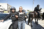 Israeli policemen detain a Palestinian protester during a demonstration against the controversial film 'Innocence of Muslims' in front of al-Aqsa Mosqe in Jerusalem, on September 14, 2012. The controversial low budget film reportedly made by an Israeli-American which portrays Muslims as immoral and gratuitous, sparked fury in Libya, where four Americans including the ambassador were killed on Tuesday when a mob attacked the US consulate in Benghazi, and has led to protests outside US missions in Morocco, Sudan, Egypt, Tunisia and Yemen. Photo by Mahfouz Abu Turk