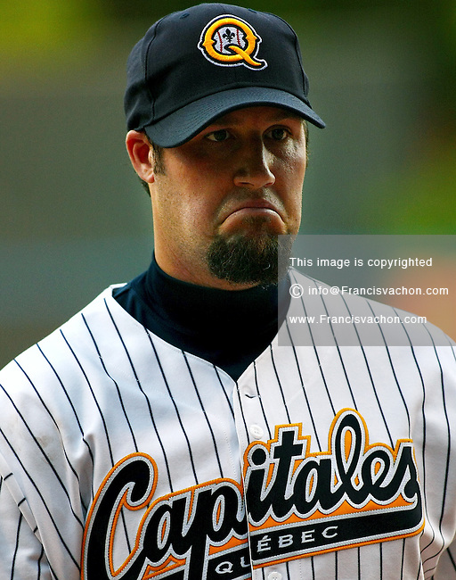 Starting pitcher Eric Gagne grimaces after a bad performance at his first game with Les Capitales de Quebec at the Stade Municipal in Quebec city June 13, 2009. Gagne, a former Cy-Young trophy winner and MLB reliever, joined the Can-Am league Capitales, to get his mojo back.