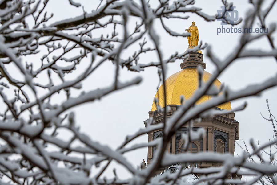January 4, 2020; The Statue of Mary atop the Golden Dome after a snowfall.  (Photo by Barbara Johnston/University of Note Dame)