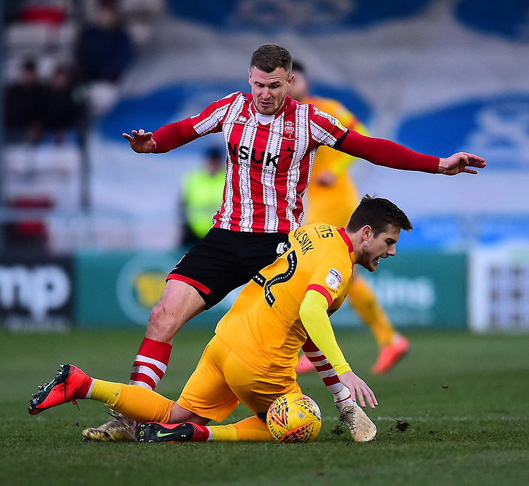 Lincoln City's Michael O'Connor battles with Northampton Town's Timi Elsnik<br /> <br /> Photographer Andrew Vaughan/CameraSport<br /> <br /> The EFL Sky Bet League Two - Lincoln City v Northampton Town - Saturday 9th February 2019 - Sincil Bank - Lincoln<br /> <br /> World Copyright &copy; 2019 CameraSport. All rights reserved. 43 Linden Ave. Countesthorpe. Leicester. England. LE8 5PG - Tel: +44 (0) 116 277 4147 - admin@camerasport.com - www.camerasport.com