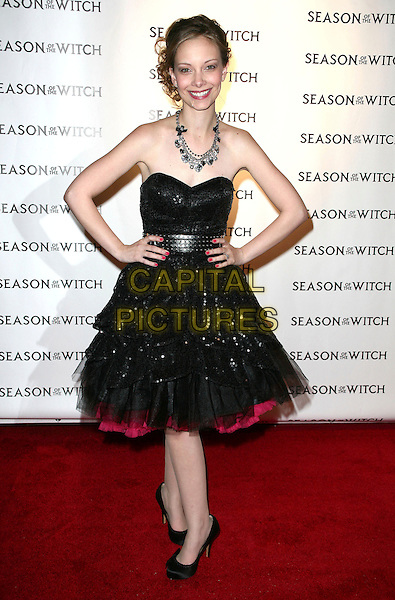 REBEKAH KENNEDY .Relativity Media's premiere of 'Season of the Witch' at AMC Lincoln Square Theater on January 4, 2011 in New York City, New York, NY, USA, .4th January 2011..full length strapless red dress hands on hips black tulle prom shoes .CAP/ADM/PZ.©Paul Zimmerman/AdMedia/Capital Pictures.