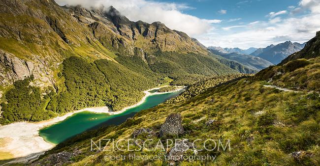 Emerald green Lake Mackenzie on Routeburn Track under Ailsa Mountains, Fiordland National Park, Southland, South Island, UNESCO World Heritage Area, New Zealand, NZ