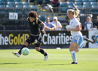 Eriko Arakawa (10) passes the ball down the field past Frida Ostberg (18) to assist teammate Christine Sinclair in scoring a goal in the first half. FC Gold Pride and Chicago Red Stars tied 1-1 at Buck Shaw Stadium in Santa Clara, California on June 7, 2009.