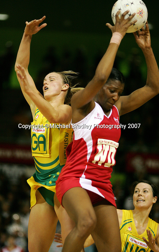 16.11.2007 Australian Sharelle McMahon and England's Amanda Newton in action during the Australia v England match at the New World Netball World Champs held at Trusts Stadium Auckland New Zealand. Mandatory Photo Credit ©Michael Bradley.