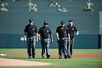 Umpires Jeremy Riggs, John Bacon, Junior Valentine, and Alex Tosi walk onto the field before an Arizona Fall League game between the Surprise Saguaros and the Salt River Rafters at Salt River Fields at Talking Stick on November 5, 2018 in Scottsdale, Arizona. Salt River defeated Surprise 4-3 . (Zachary Lucy/Four Seam Images)