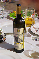 On the dining table, bottle of wine Misno Vino 2004, Zilavka grape variety, Obiteljski Podrum Rozic. Restaurant Restoran Rondo on the Rondo Square Historic town of Mostar. Federation Bosne i Hercegovine. Bosnia Herzegovina, Europe.