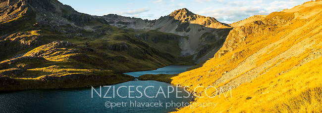 Sunrise over pristine Hinapouri Tarns, Nelson Lake National Park, South Island, New Zealand, NZ