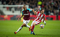 Joao Mario of West Ham United & Joe Allen of Stoke City during the Premier League match between West Ham United and Stoke City at the Olympic Park, London, England on 16 April 2018. Photo by Andy Rowland.