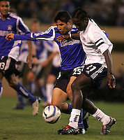 2 April 2005: Brian Ching of Earthquakes battles for the ball against Shalrie Joseph of Revolutions at Spartan Stadium in San Jose, California.   Earthquakes tied Revolution, 2-2.  Credit: Michael Pimentel / ISI