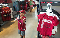 NWA Democrat-Gazette/BEN GOFF @NWABENGOFF<br /> Brady Thomas, 5, of Van Buren, shops Wednesday, Aug. 7, 2019, at the new Hog Heaven shop on the North side of Reynolds Razorback Stadium in Fayetteville.