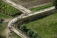 "Birds view of the peloton<br /> <br /> Antwerp Port Epic 2018 (formerly ""Schaal Sels"")<br /> One Day Race: Antwerp > Antwerp (207km of which 32km are cobbles & 30km is gravel/off-road!)"