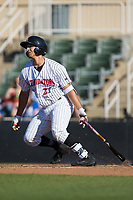 Seby Zavala (21) of the Kannapolis Intimidators follows through on his swing against the Lakewood BlueClaws at Kannapolis Intimidators Stadium on April 9, 2017 in Kannapolis, North Carolina.  The BlueClaws defeated the Intimidators 7-1.  (Brian Westerholt/Four Seam Images)