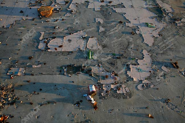 Broken beer bottles in an abandoned construction lot. Las Vegas, Nevada, USA, April 11, 2008