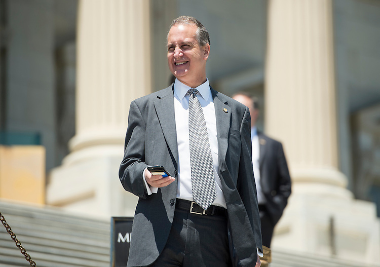 UNITED STATES - JULY 16: Rep. Mario Diaz-Balart, R-Fla., walks down the House steps following the final vote of the week on Thursday, July 16, 2015. (Photo By Bill Clark/CQ Roll Call)