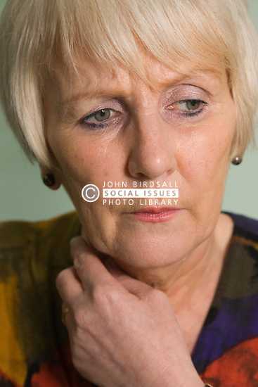 Portrait of an older woman looking worried,