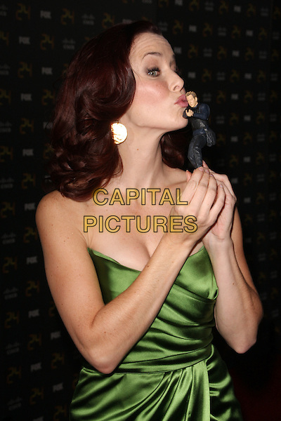"ANNIE WERSCHING.""24"" 150th Episode & Season 7 Premiere Party held at XIV, Hollywood, California, USA..January 6th, 2008.half length green silk satin strapless dress toy figurine profile kiss kissing .CAP/ADM/KB.©Kevan Brooks/AdMedia/Capital Pictures."