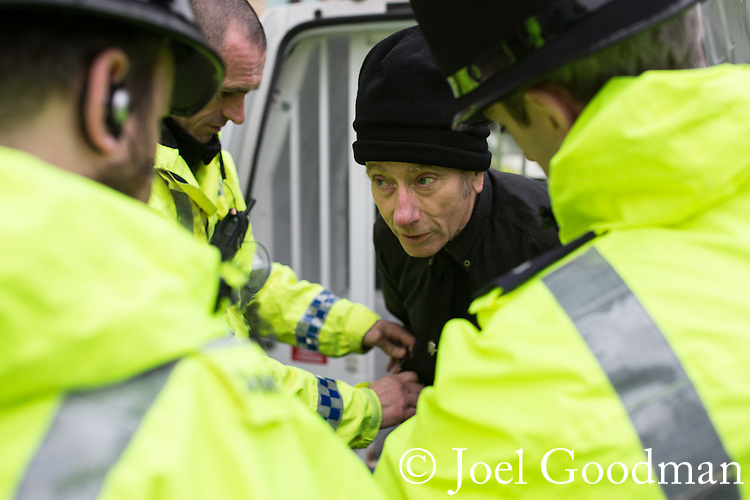 "© Joel Goodman - 07973 332324 . NO SYNDICATION PERMITTED . 21/03/2015 . Newcastle , UK . A man is arrested for Incitement to Racial Hatred . Neo-Nazis and skinheads from across Europe organise a "" White Man March "" in Newcastle , under the banner of "" National Action "" , opposed by "" North-East Anti-Fascists "" . Photo credit : Joel Goodman"